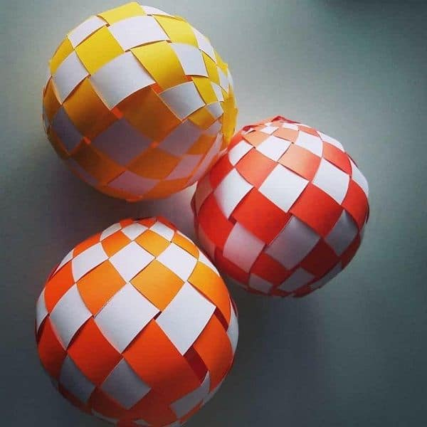 Christmas balls made of strips of colored paper